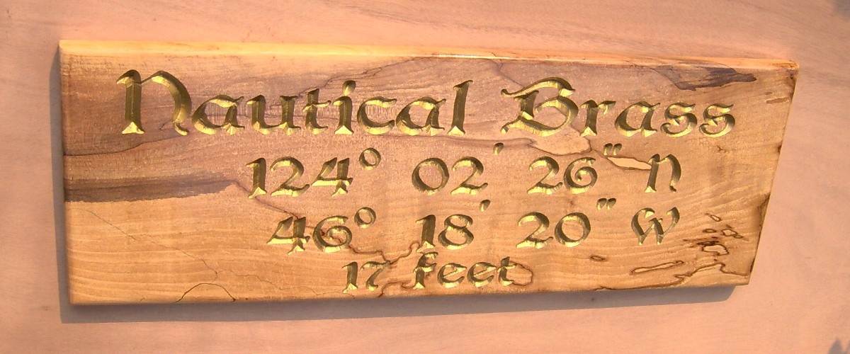 Spaulted maple with brass lettering